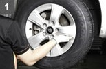 < Remove a tire and wheel from a vehicle. >